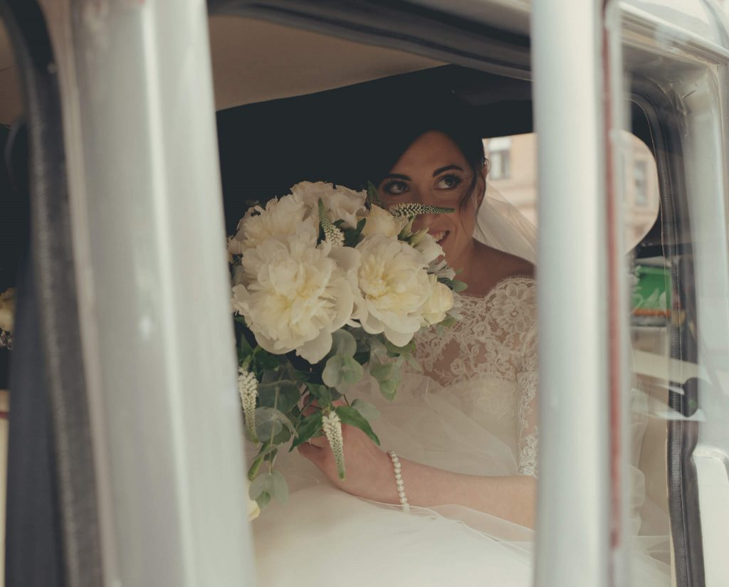 Beautiful Bride in car - captured by Scottish Wedding photographer, Ali Crawford